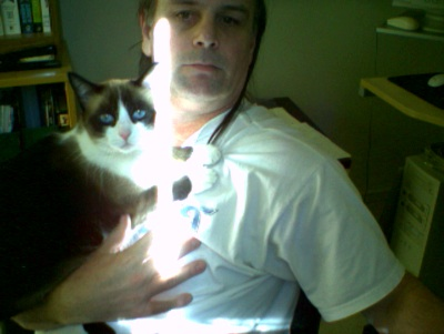 infidel-with-his-cat-annalise-jim.jpeg